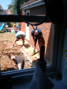 Builders working hard to deepen the trench
