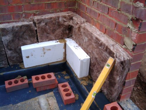 Cavity Wall Insulation Added Between Bricks And Blocks