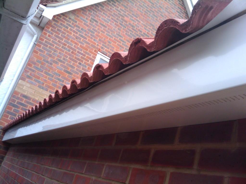 Tiles over the felt, over the fascia board
