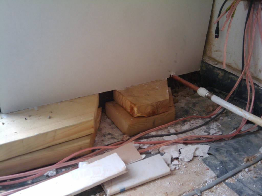 Various items keeping the plasterboard in place