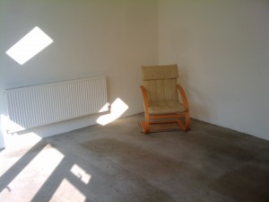 A chair and a small carpet - the first furnishings