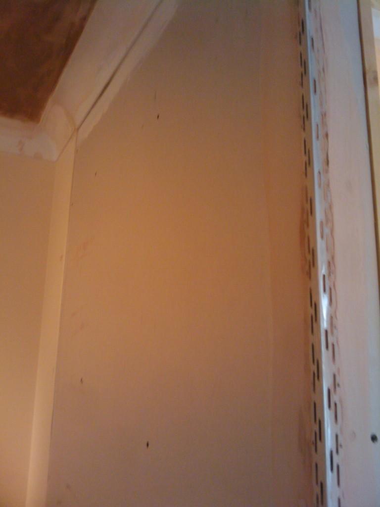 Metal edge on the new doorway, awaiting plastering