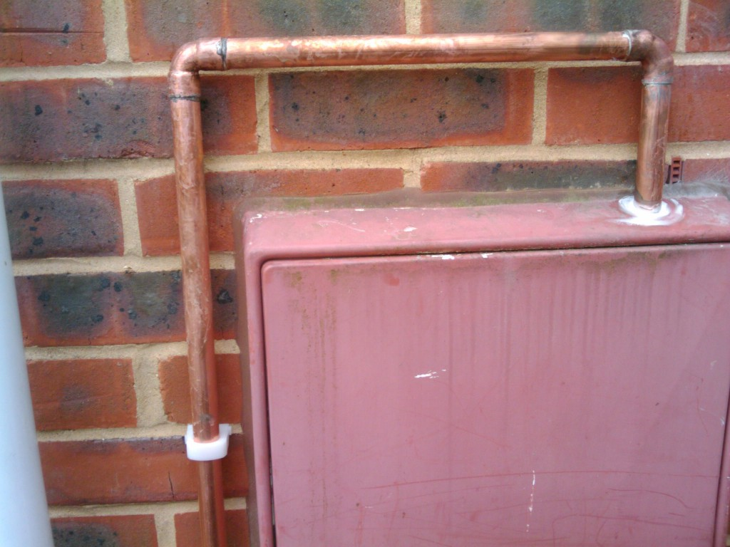 Pipe coming out of the gas meter box