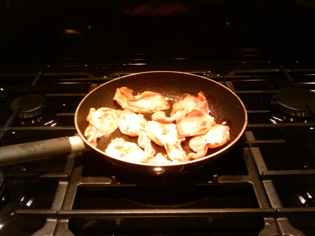 The first fried bacon on the big wok ring