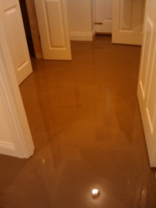 Latex screed poured onto floor. It is not actually latex, but they still call it that. More like a really runny plaster that sets like concrete.