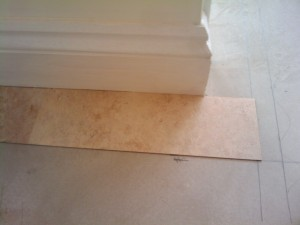 The first Karndean tiles laid on the border