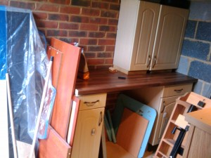 Old kitchen units used to make work bench in the garage