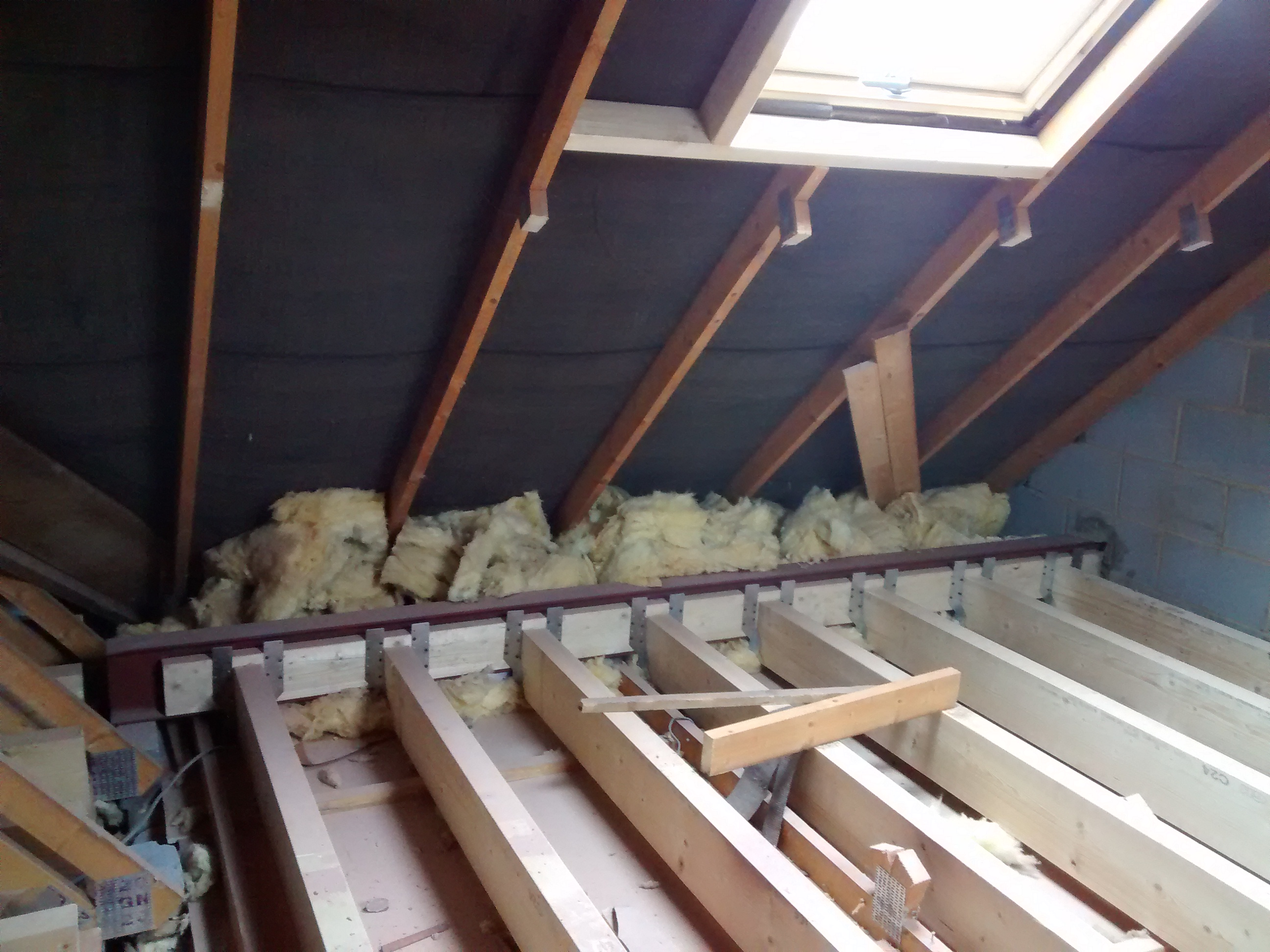 Removing the Web Supports and Installing Floor Joists - Loft