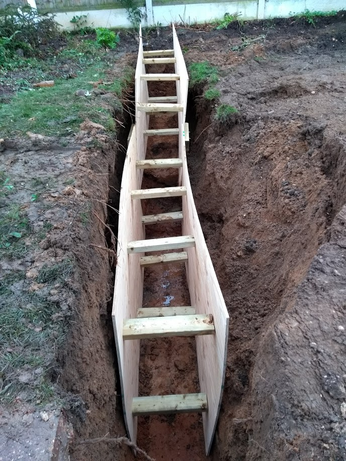 foundation trench with wood wall supports