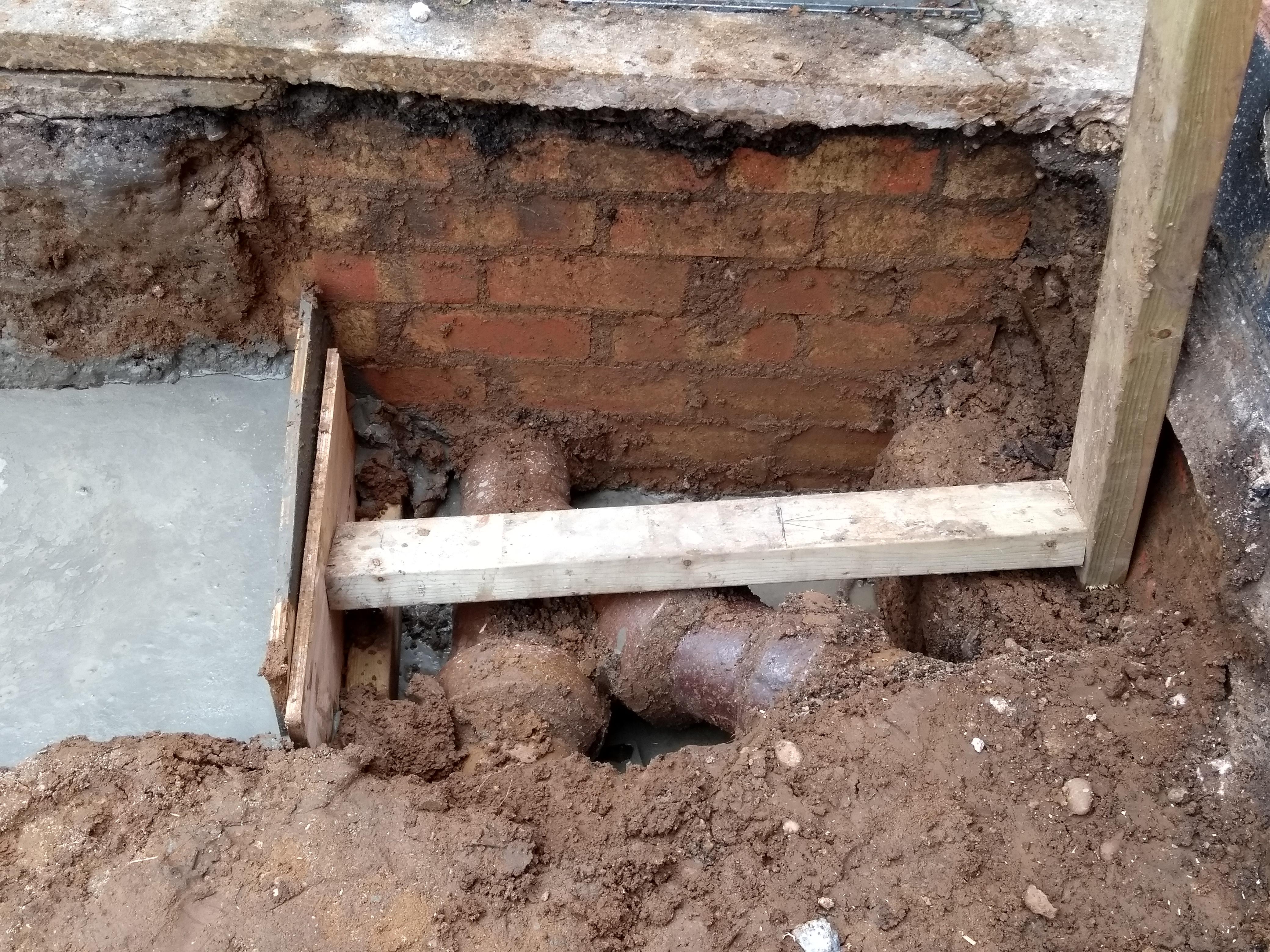 concrete poured around drainage pipes