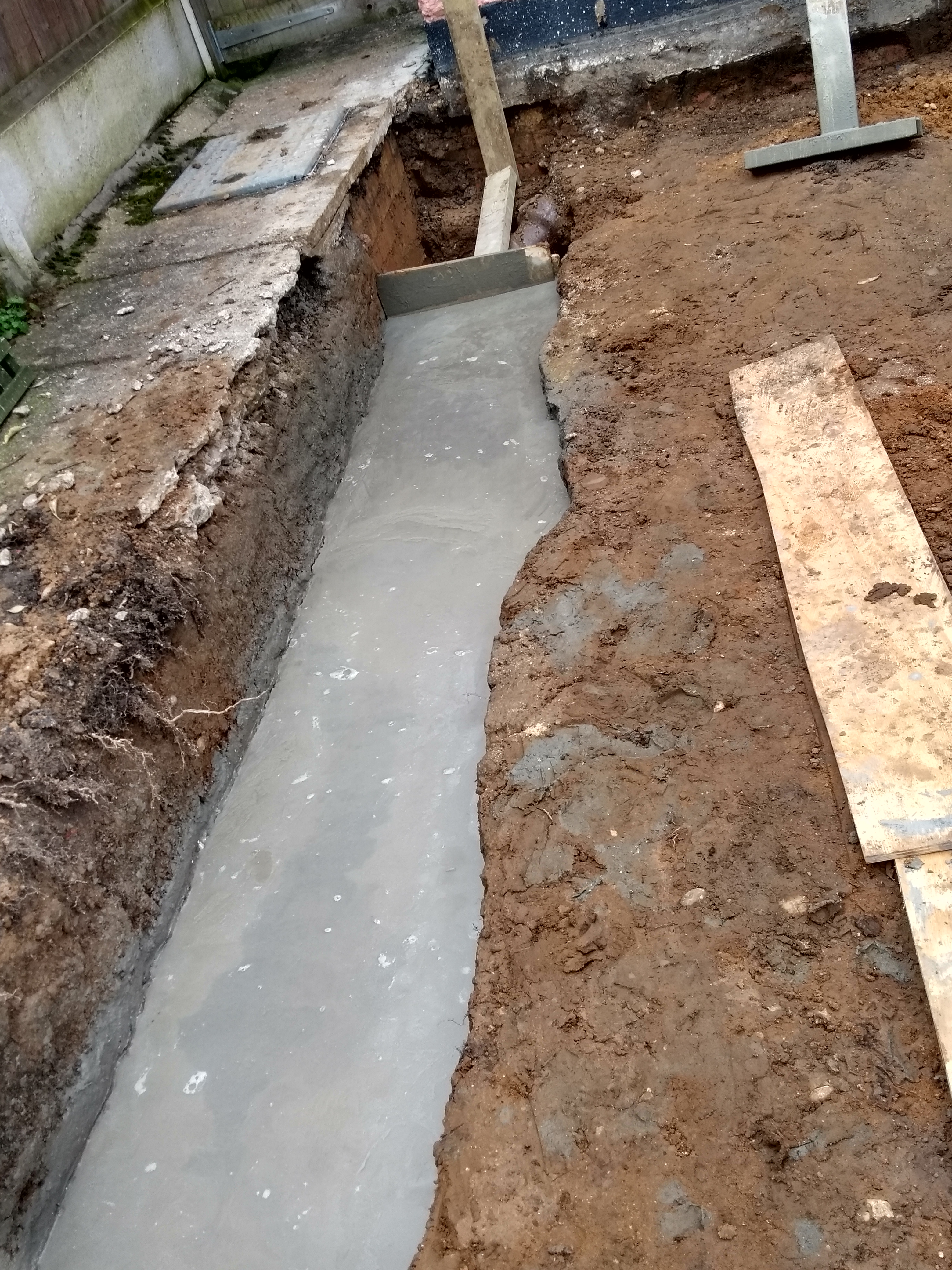 smooth concrete in foundation trench